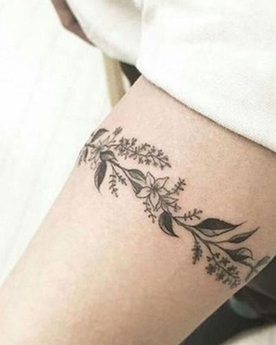 tatouage Couronne autour de la cuisse