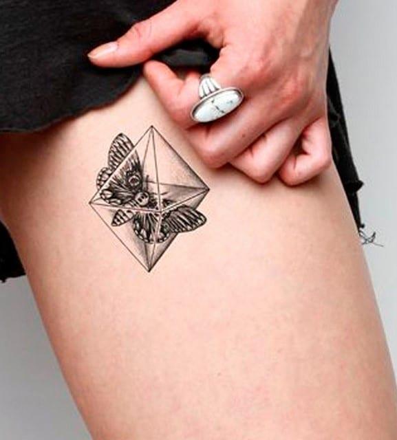 tatouage Papillon cuisse