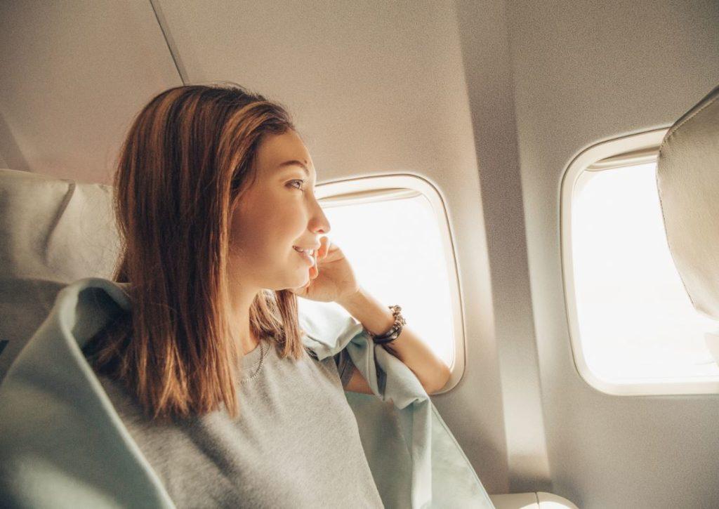 Femme Voyage Avion Zen