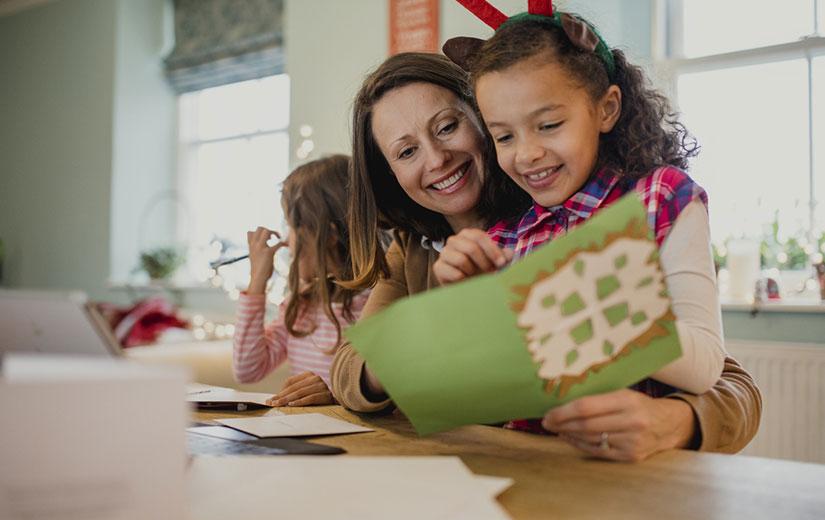 écrire une Carte de Noel avec les enfant